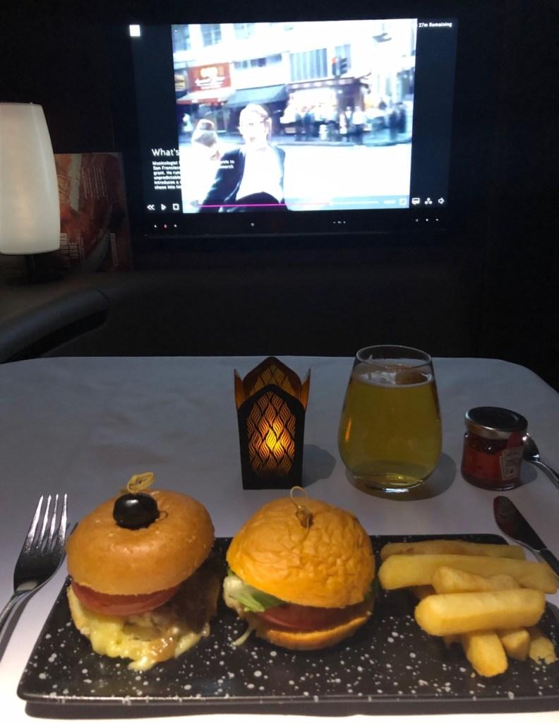 qatar airways first class airbus a380 doh doha fra frankfurt qr67 onboard bar burger