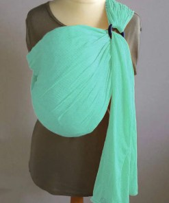 Emerald green water ringsling displayed on a mannequin