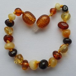 Polished mixed amber anklet arranged into a heart
