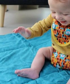 Baby wearing Close Pop-in Gen V2 Printed Nappy & Bib Ticky & Bert