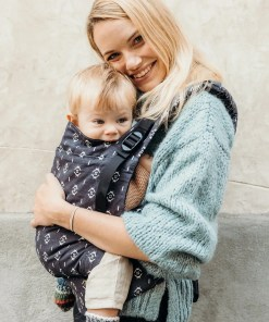 Woman hugging baby in a dark grey sling