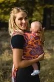 Smiling woman holding baby in SMP stretchy wrap