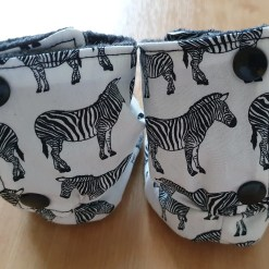 Rear of Packaging of White stay-put boots with zebra design