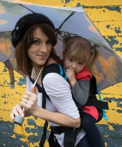 Woman and toddler smiling under an umbrella using a Mamaruga Zebulo Forest Fairy
