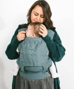 Woman wearing baby in Neko Switch Lycia Clover
