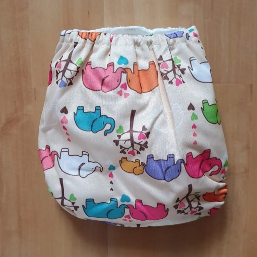 Rear view of Elephant family print Littles & Bloomz newborn nappy