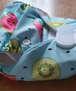 Side view of Littles & Bloomz newborn nappy