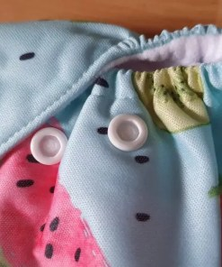 Close up of leg opening and rise poppers on L&B newborn nappy