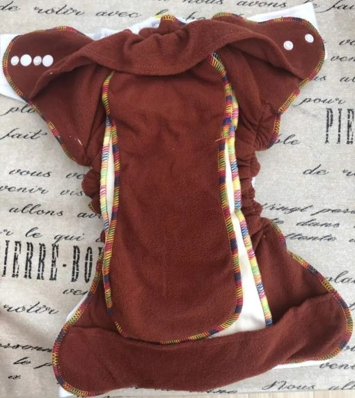 Inside Bells Bumz Fitted Hemp and Bamboo Nappy showing coffee fibre lining