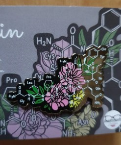 Oxytocin symbol pin badge with pink and yellow flowers