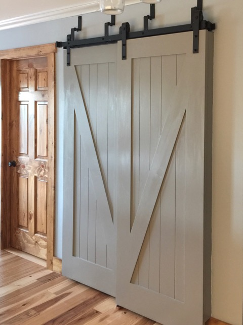 Created a much larger pantry with sliding barn doors.