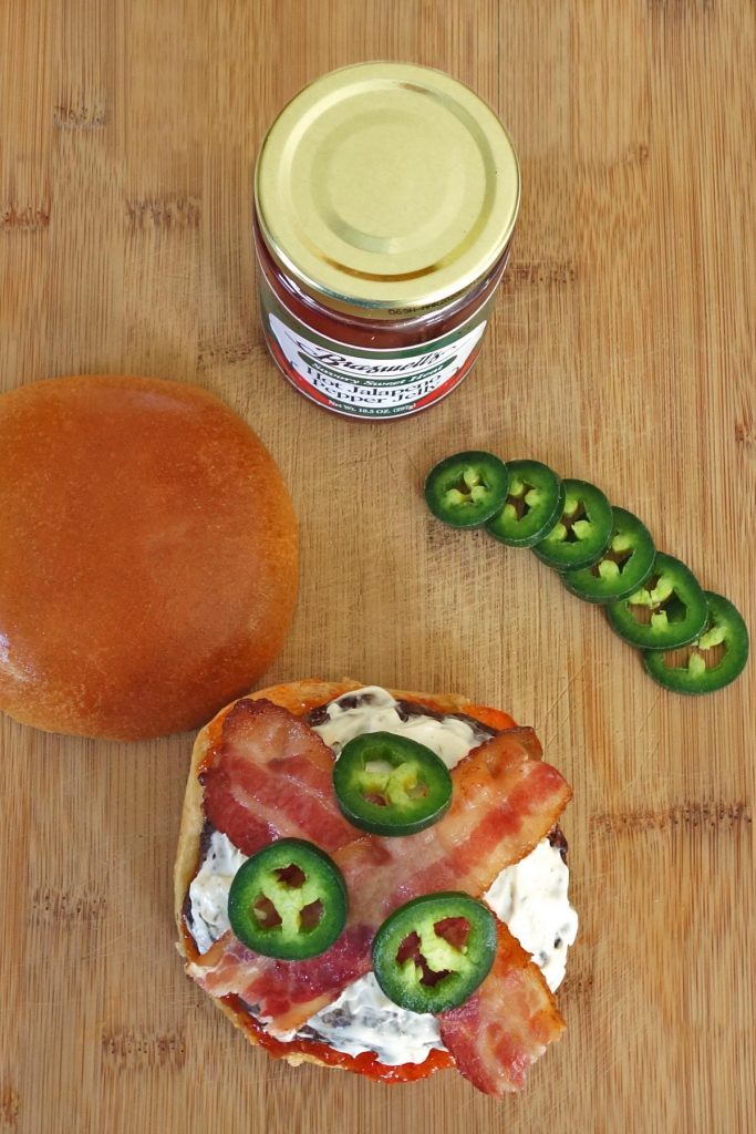 Jalapeno Burger with Cream Cheese, Bacon, and Jalapeno Jelly. This burger melts in your mouth with a kick of spice!
