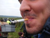Porteur Romain, a gentle giant or something else, but with ever present cigarette in Fuji close up.