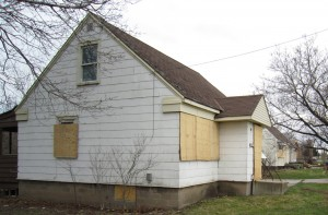 Three houses that front on Queensway west of Guelph line wait for the wrecking ball and the creation of a development that will create 58 housing units in a community that has had nothing but small bungalows.