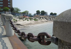 Mother nature created this nice little beach for us – and now the engineers want to construct a stairway from the deck to the water level.  Why not just open up the anchor chain on the Promenade to the water level.  What will you bet that there is an insurance reason for not being able to do that?
