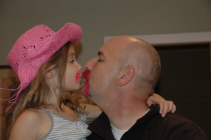 The boys won the bet - the daughter got a kiiss and a pink mustache of her own.