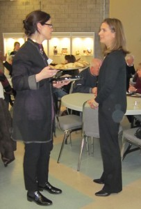 Anne McIlroy on the left, who served cookies to the 25+ people who attended the meeting, talks with with Andrea Smith