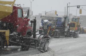Snow plows in tandem