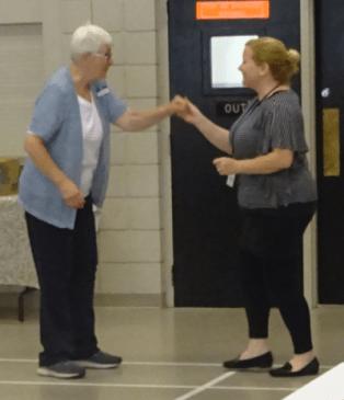 Staff dance at sesnior event
