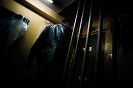 Bodyguard opens the door to SouichirouÕs office in Kabukicho, Tokyo - 2009