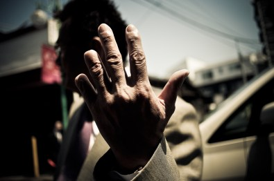 A senior member of the Odo family ostentatively shows his hand with missing digits on two fingers. To lend weight to his apology for a wrongdoing, one severs a digit from his own hand with a knife, while the person he is apologizing to watches, and subsequently offers the severed digit as a token of his apology. Nowadays, this is still commonplace within the Yakuza - 2009