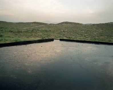 Oil reservoir for the Naftalan sanitoriums, Azerbaijan.The story goes that in 1870 an Azeri spice merchant was passing through the area when his camel fell ill, and he decided to abandon it. On his way back some months later, he discovered to his amazement, the very same animal, apparently fit and healthy, basking in a pool of black oil.