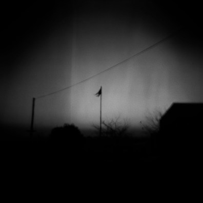 A lonely flag stands tall as the sun sets in Diepsloot
