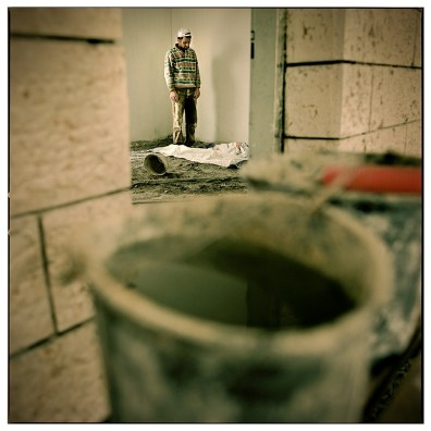 Maher, a Palestinian worker, praying on a break while building the setelment of Beiter Ililt.