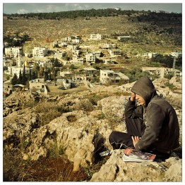 Karim is studing for an exam, near his home at Wadi Fuqin. The youth of the village is highly educated and most of them continue to study in University.