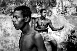 Two young boys with no education or work go to the occupied chocolate factory to take drugs. They are talking about how the police was entered in his favela last night. Brazil's murder rate is now the highest in the world. The gravity of this spreading violence is becoming more and more intense.