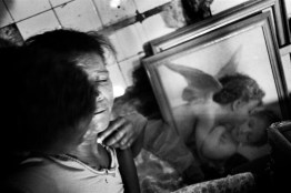 Noemi (38) is criying with her son because is the anniversary of the death of her brother and her husband. Since then she began to split into prostitution to survive.