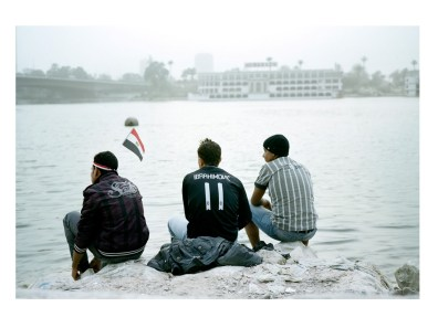 Mohammad 17; Ibrahim 16 and Islam 17 years; watching the boat freshly getting out on the Nile. They want to be singer; fashion designer and football player now that the country takes a breath of democracy, Egypt.