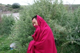 """A Tibetan monk on the Qinghai-Tibetan Plateau. Many of the forests of the region have been felled and as a result are detrimentally affecting many of the ecosystems on the """"roof of the world""""."""
