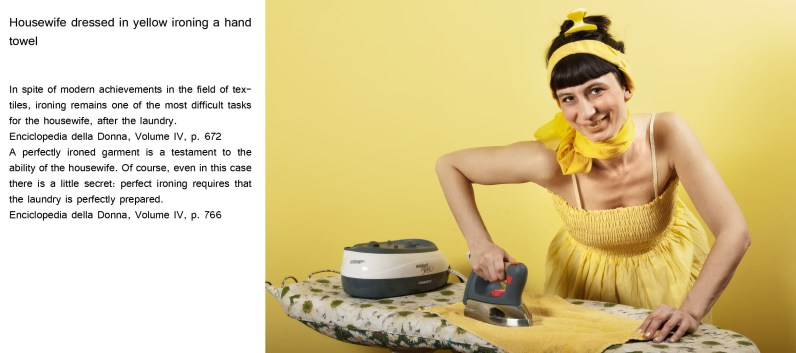 Housewife dressed in yellow ironing a hand towel