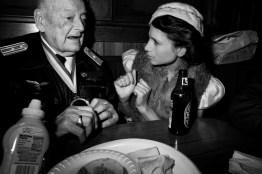 Leni Riefenstahl shares a meal with Gottfried Dulias, who was a former WW II Luftwaffe pilot and P.O.W. of the Gulan, Russian death camp.