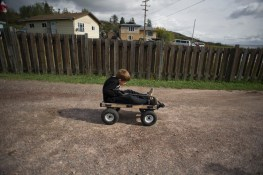 A child plays outside his grandfather's home in Fort Chipewyan.