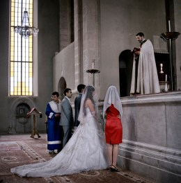 "Father Andreas marries Ara Avagimyan and Elita Khachaturyan at Ghazanchetsots church in Shushi, Nagorno Karabakh on the 22nd July 2011. The young couple will receive a wedding payment of approximately €575 (300,00 ad) as part of the government's ""Birth Encouragement Program""."