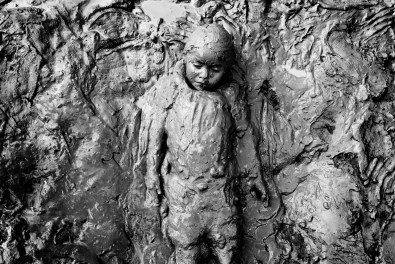 Ecuador, Amazon. December 2011. A girl called Leila covered in mud. There were more children in the place, the bank of a river in a community affected by oil pollution called Dayuma. They were playing to cover themselves in mud, for fun. Then they remove the mud with a dip in the river.