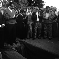 """Family members and friends applaud during the funeral of Horacio Bau a left-wing montonero militant from Trelew in the Argentine Patagonia region who disappeard in La Plata, Argentina in november 1977. His remains were found buried in a cementery in the city of La Plata as a """"no name"""" in early 2007 and the burial cerimony took place in Trelew in November 2007. Trelew, Argentina, November 2007."""