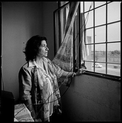 Anahit Aharonian, looking from the window of her former cell in the Punta de Rieles prison in Montevideo, Uruguay. Ms Aharonian is a descendant of survivors of the Armenian genocide and was born in Uruguay. She became involved with politics in her teenage years and embraced the Tupamaro movement. She was arrested by the military during the early days of the Uruguaian dictatorship, having spent 12 years in jail. Montevideo, Uruguay, February 2012.