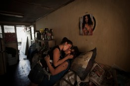 "Nataly and Diandra kiss. A very important amount of young women in Santiago's shantytowns became lesbians, tired of men's violence. The ""femicides"" (murder of a woman resulting from gender violence) happen every week, so they rather look for shelter with female couples."