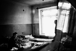 A seriously ill patient (left) sitting in a ward in Mariupol. He is living with HIV, has hepatitis and drug-resistant tuberculosis and uses intravenous drugs. Across the street from this tuberculosis clinic is a clinic for drug users, where patients get their daily doses of a synthetic opioid substitute drug.