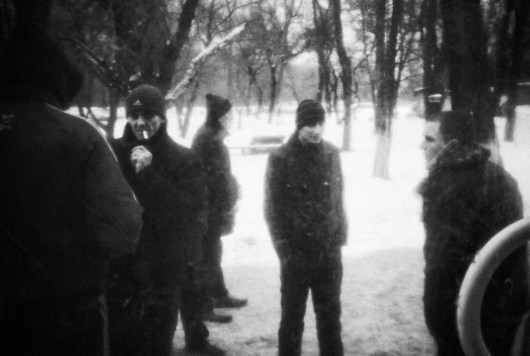 A group of tuberculosis patients with various degrees of drug resistance have a smoke just outside a tuberculosis clinic in Donetsk.