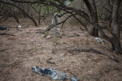 Clothes discarded by migrants are seen at a pickup point on the El Tule Ranch.