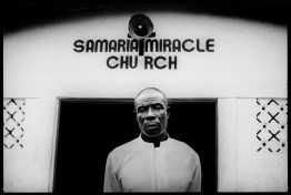 Samaria Miracle chuch pastor poses in front of his healing chuch