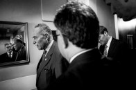 """Senate Rules and Administration Chairman Chuch Schumer (D-NY) confers with Senator Al Franken (D-MN) following a news conference on Capitol Hill Wednesday to announce new legislation """"to blunt the worst effects"""" of the Supreme Court's Citizens United v. Federal Election Commission decision."""
