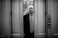 Senator John McCain (R-AZ) rides an elevator after speaking to reporters outside of the Senate Chamber on Capitol Hill following him introducing a Senate resolution calling for an independent investigation of the national security leaks within the Obama administration.
