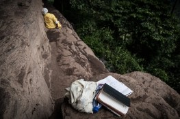 Ghana, Kumasi region,Atwea mountain, a woman stays away from people spending her time on prayer and fasting