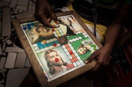 The name and image of Jesus are widely used in Ghana. Various posters and billboards, shop names, buses and taxis, beauty saloons and restaurants contain images of Jesus Christ. The popular game 'Ludo' features Jesus Christ on one side and a snake on the other side.