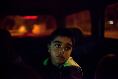 Four year old Kade Cattermore waits in the car while his mother buys alcohol from the local bottle shop. David Maurice Smith/Oculi.